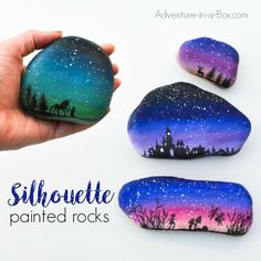 Decorate rocks with elegant landscape silhouettes drawn over the starry twilight sky!Simple rock painting technique that even kids can use. Silhouette Painting, Landscape Silhouette, Silhouette Design, Tree Silhouette, Robert Rock, Christmas Rock, Pebble Painting, Pebble Art, Stone Painting