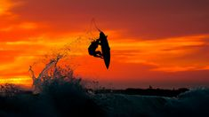 Catching some air at sunset. Photo by Chris Burkard [2048x1152][OS]