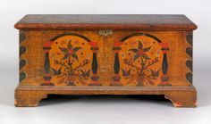 Berks County, Pennsylvania painted pine dower chest dated 1798, the facade decorated with 2 tombstone panels with potted flowers and column sides flanked by heart corners on an ochre sponge ground, 22.75 H. x 45.75 W.