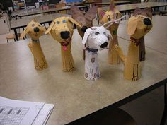 paper mache pets with cones and newspaper
