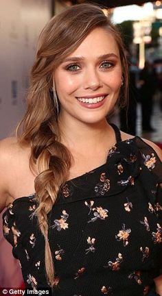 Plaits please! Elizabeth Olsen, 28, wowed on the red carpet for the premiere of her film Wind River in LA with a messy-on-purpose side braid and natural-looking make-up