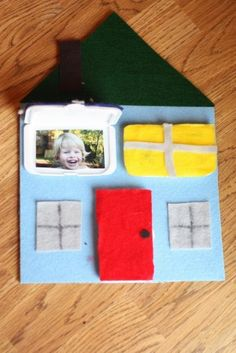 little peek-a-boo house using diaper wipe container closures for windows