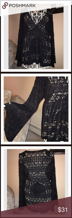 🎉HP 5-9🎉NWOT Torrid Lace Bell Sleeve Top This is a NWOTS lovely Torrid Bell Sleeve Lace Top. Call us drama queens, but we like all eyes on us and this top definitely helps our case (and then some). The black lace is totally sheer, with a v-neck that'll show off even more. The sweeping bell sleeves got us making an entrance and then some. Torrid Tops Blouses