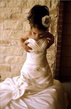 So adorable. Take a picture of your flower girl in your wedding dress and give it to her on her wedding day.