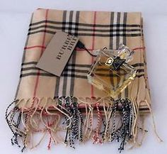 Burberry...JUST GOT THIS SCARF FOR CHRISTMAS....THANK YOU MOM & DAD!!!!!! LOVE LOVE LOVE BURBERRY!!!!!!!!!!!!!!