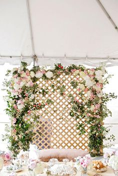 Dreamy floral lattice backdrop by Bows + Arrows for the wedding ceremony. Photo…