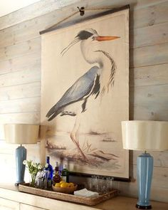 Tapestry ... have Walmart print a canvas photo, add two rods, and some nautical rope at the top and viola! Beach wall decor idea | Coastal wall art ideas