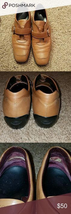 Tod's shoes TODS Brown leather slip-on with buckle shoes. See pictures for details inside shoe heel area shows wear.  This shoe is pre owned condition but still very wearable smoke free home Tod's Shoes