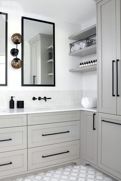 A cool contemporary bathroom. A neutral envelope, hits of black, subtle pattern and savvy storage give this bathroom a sleek, modern vibe. home accent, Square Bar Kitchen Cupboard Handle Pulls Black Cabinet Hardware Drawer Pulls Knobs Grey Bathrooms, Bathroom Renos, Beautiful Bathrooms, Bathroom Interior, Modern Bathroom, Bathroom Storage, Bathroom Ideas, Minimalist Bathroom, Bathroom Vanities