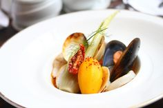 """""""Fisherman's Stew."""" Fresh prawns, clams, mussels, chunks of butter-sealed Dover sole. Served in a saffron-infused rouille with fennel bulb and sun-dried tomato."""