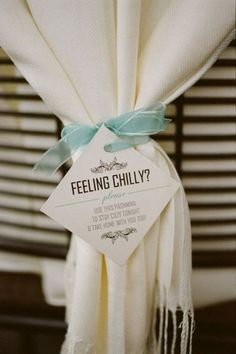 I love the idea of pashmina scarves as favors. Very cute if you drape them around the chair backs. | DIY Wedding Decor | Unique Wedding Favor Ideas | Winter Wedding