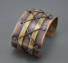 "Winifred Mason Modernist Copper/Brass Bracelet Chenet; 1 3/16"" tall; interior circ 7 1/8""; rear opening 1.5"""