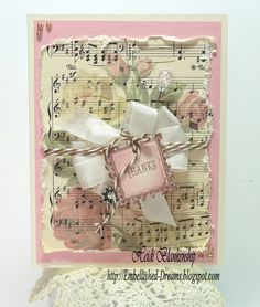 like the music background with bow and tag tied with baker's twine.