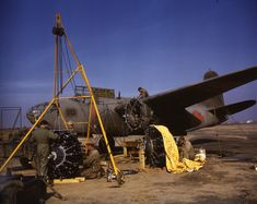One-half left front view of a U. Army Air Force Douglas Havoc (s/n being worked on, the aircraft's engines are in the foreground; probably taken during field maneuvers/War Games in Aircraft Engine, Ww2 Aircraft, Military Aircraft, Aircraft Maintenance, Navy Marine, Aircraft Photos, Photos Of The Week, Usmc, World War Two