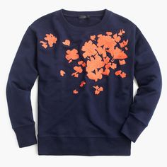 Consider this embroidered layer your new dressy sweatshirt this winter. Slim fit. Body length: 24. Cotton. Import.