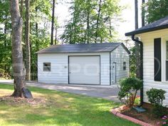 This beautiful garage storage building looks great in this wooded backyard. It fits well with the look of the home and adds value to the property.