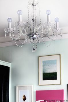 from the Hunted Interior - chandelier with round bulbs...fresh