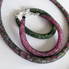 """""""This is an inexpensive version of the Swarovski bracelets and necklaces. The pattern of this set is to die for, and will be sure to set you apart at any event or celebration. The colors are eye catching and stunning."""""""