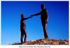 Hands Across the Divide:Peace Monument, Derry City. The Good Friday Agreement (GFA) or Belfast Agreement was a major political development in the Northern Ireland peace process of the 1990s. Northern Ireland's present devolved system of government is based on the Agreement.