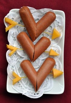 Cupid heart dogs.  Held together by toothpicks with cheese.  Easy and kid-friendly.  Going to add ketchup in a heart shape.
