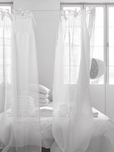 There's something about these sheer white, tab-top curtains that makes every thing look cooler.  I like to hang these in the summer to make things look breezy...