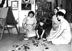 Nurses celebrate Christmas with a patient at Great Ormond Street Hospital in 1980