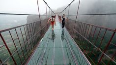 A skywalk in central China's Hunan Pingjiang offers a spectacular view. The bridge hangs 180 meters above the ground, is 300 meters long and is made of wood and plexiglass.