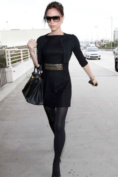 VB in a little black dress. opaque stockings. Black heels and a little black cardigan. funkied up with a cool belt