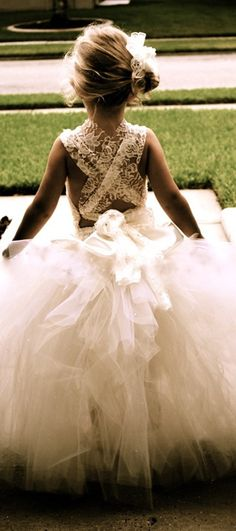 flower girl with a beautiful sweet lace criss cross back...this is something that could be done with that prom dress I can never sell!