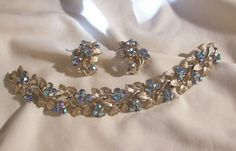 Outstanding Peacock blues rhinestone Parure Bracelet and Earring set marked BSK In excellent condition