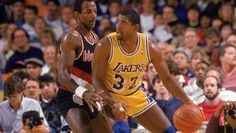 -Magic Johnson (32) of the Los Angeles Lakers posts up Clyde Drexler (22) of the Portland Trail Blazers during an NBA game at the Great Western Forum in Los Angeles.