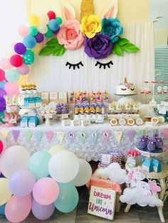 What a dreamy Unicorn birthday party! The balloon garland and backdrop are stunning!! See more party ideas and share yours at CatchMyParty.com #unicorn #balloongarland #backdrop
