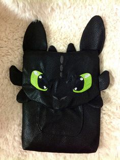 Toothless the Dragon is ready to guard your iPad! This fun ipad cover is made of a velvety faux leather with embroidered eyes, nose, and head