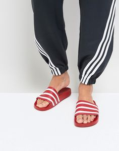 db32cc2eb Shop adidas Originals Adilette sliders in red 288193 at ASOS.