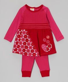 It's the essence of cheerful! This matched set brightens any little girl's day with a precious design and vibrant color. The stretchy cotton dress has a generous neck for easy changing, and the leggings bring a kick of warm whimsy to the ensemble.