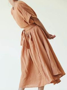 Slip on linen. Relaxed boxy fit with wide sleeves. Waist length. Colors- Rust (muted color) / Paprika (bright color) Fabric- 100% linen. Made in USA. *ships February 20th.