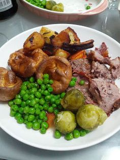 Easter dinner. Roast lamb, roast potatoes, yorkshire puddings, sprouts, carrots and peas. Topped with gravy. Yummy!