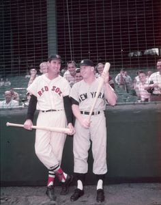 Ted Williams of the Boston Red Sox and Mickey Mantle of the New York #Yankees, in uniform with baseball bats, Boston, Massachusetts, circa 1955. (Photo by Hulton Archive/Getty Images) #RedSox #Yankees #baseball #mlb