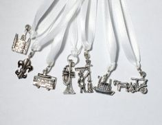 Cake pulls: Set of 7 New Orleans pewter charms on ribbon. The set comes with a card for each of the charms with it's meaning, so the girls who pull will know what their charm means.