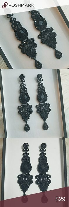 "Adia Kibur Black Linear Gem Earrings New! NWT Adia Kibur Black Linear Statement Earrings   Encrusted with black Crystals, 4"" drop  Brand New with tags attached! NWT  Perfect for the holidays! Even PRETTIER in person! Hard to photograph  Chrismas  New Years Holiday Party Vegas   Click 'Add to Bundle' for a special offer from me, add any other items you like for an even better discount!  I ship same day or next business day Adia Kibur Jewelry Earrings"