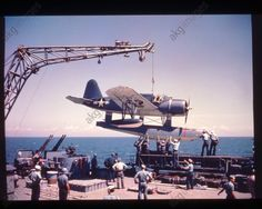A Vought OS2U Kingfisher reconnaissance plane (catapult aircraft) of the US Marine Corps is raised on board the USS Missouri. Photo, undated (c. 1945). Portland would have had similar planes.