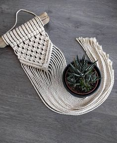 This macrame wall pendant is knotted of 4 mm punched/twisted cotton cord and hangs on a sturdy and thick piece of driftwood, originating from Latvia. Dimensions* • Dimension of driftwood: 26 cm • Width macrame: 16 cm • Length macrame: 80 cm, measured from top branch to longest point