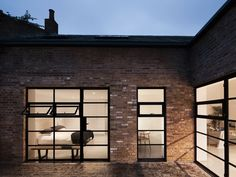 A Forgotten Warehouse Is Reborn Into a Light-Filled London Home - Photo 3 of 12 - Gridded steel frame windows have been added throughout the home to provide natural daylight to the city dwelling, unique for a London residence of this type. Halle, Warehouse Living, Brick Siding, Two Bedroom House, Fixer Upper House, Road Pictures, Warehouse Conversion, Roofing Materials, Old Buildings