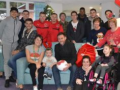 Fleetwood Town's players and management team visited Brian House Children Hospice in Bispham and handed out Christmas presents to the children.