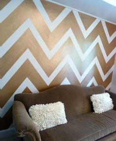 """The wall in the sitting area of this home office had nothing going on until I painted"""" """"these bold chevron stripes on it. Decided on a coppery metallic paint for them against"""" """"pinkish wall. Two step-paint process and lots of tape - but definitely worth the effort"""" """"Chevron metallic wall"""" """"Accent wall...chevron walls?...Wall idea...Pattern wall...Chevron Wall"""""""