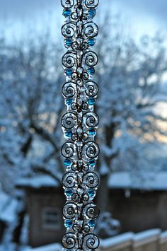 I didn't think a rainchain could get better! Copper Rain Chain with blue glass balls, frozen.