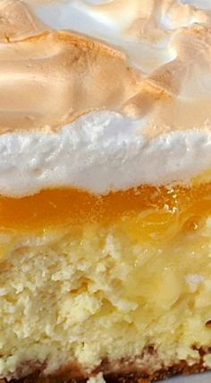 Lemon Meringue Cheesecake ~ A creamy, tart, delectable desserthe... T best of two desserts.
