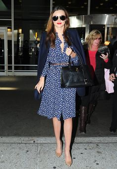Pin for Later: Miranda Kerr Has an Outfit For Just About Everything  Miranda always inspires us to dress up when traveling. Here, she was true blue in a printed dress and solid blazer.