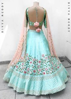 A fresh breath of teal blue, is back to make this summer pleasant. Pure handloom tussar silk embroidered with thread, badla and zardozi is… Choli Designs, Lehenga Designs, Blouse Designs, Indian Lehenga, Red Lehenga, Lehenga Choli, Floral Lehenga, Anarkali, Indian Attire