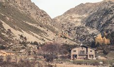 In one of Europe's most hidden valleys, a community-minded mountain lodge frames natural beauty with a gentle, slowed-down hospitality concept. Inspiration comes from the outside in, with natural materials setting the scene for inviting spaces and objets d'art. Andorra, Concrete Floors, Lodges, View Photos, Grand Canyon, Photo Galleries, Architecture, Mountain, Travel